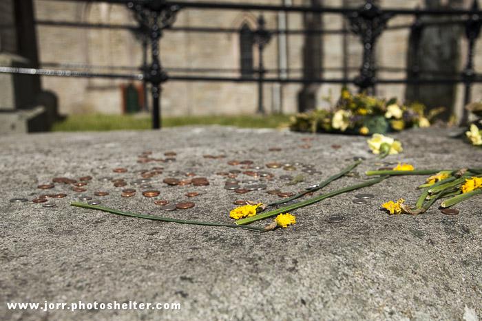 St. Patricks Grave, coins, flowers, Downpatrick, J Orr