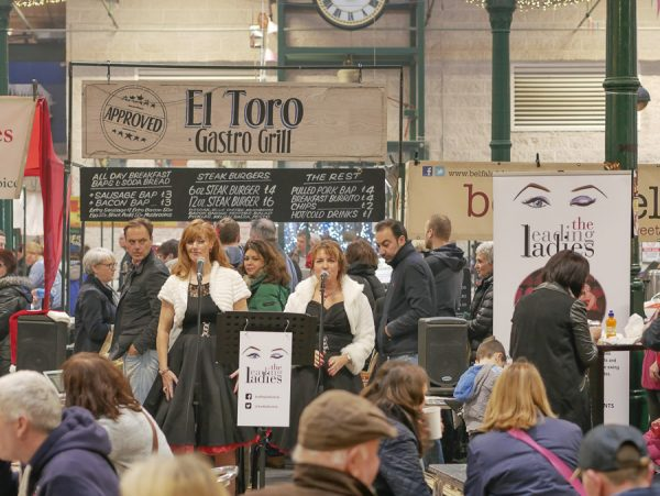 Belfast, Northern Ireland, UK, 10th December 2016. St. George's Market on a Saturday afternoon. The Leading Ladies entertain