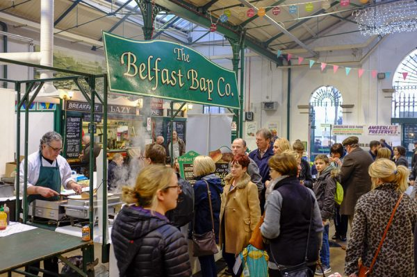 Belfast, Northern Ireland, UK, 10th December 2016. St. George's Market on a Saturday afternoon. Queuing for food at The Belfast Bap Company stall.