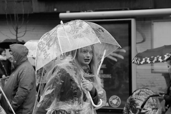 Rain capes and umbrellas at St Patricks parade, Belfast